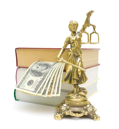 statue of justice, money and a stack of books isolated on white close-up photo