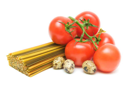 pasta of different colors, ripe tomatoes and quail eggs isolated on white background close-up