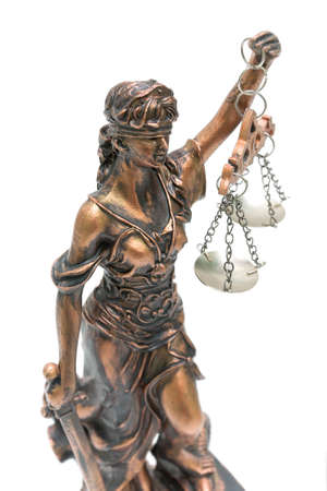 statue of justice close up on white background Stock Photo