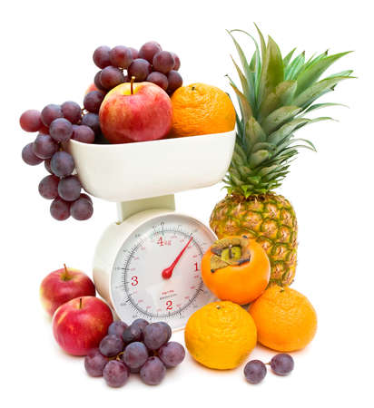 red gram: kitchen scales and fresh fruits isolated on white background