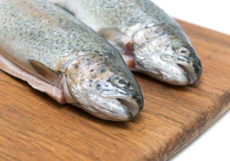 fresh raw fish trout on a cutting board close up photo