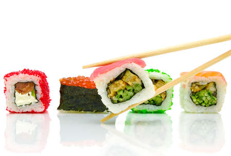 various japanese sushi and chopsticks on a white background close-up