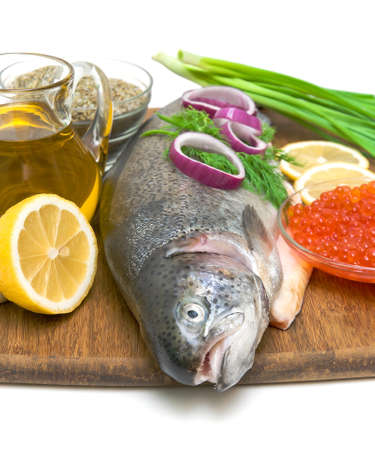 trout, caviar, lemon, vegetables, spices and olive oil on a white background close-up Stock Photo - 17534617