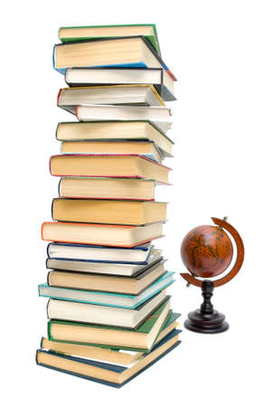 large stack of different books and old globe isolated on white background Stock Photo - 17534621