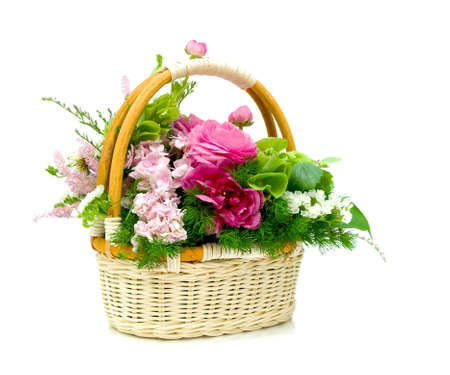 Wicker basket with fresh beautiful flowers isolated on white background photo