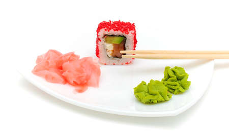 Japanese cuisine. rolls, wasabi and pickled ginger on a plate on a white background. photo