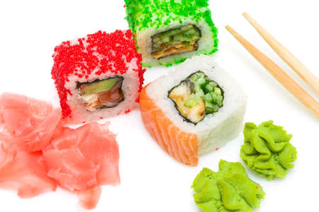 rolls, wasabi, pickled ginger and chopsticks on white background. Top view. horizontal photo. photo