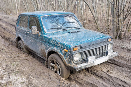 Russian-made SUV driving on poor forest road