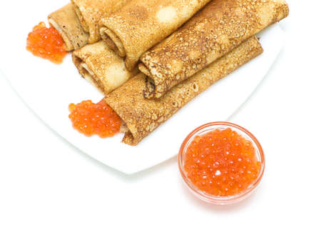red salmon caviar and crepes on a plate on a white background  Top view  horizontal photo Stock Photo - 18513175