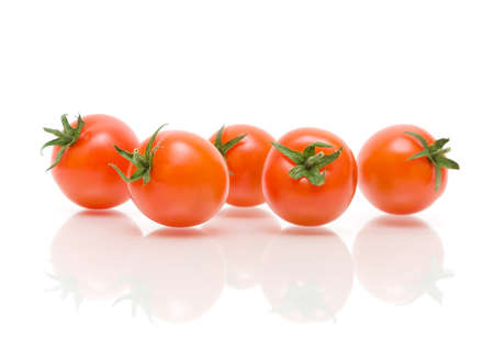 ripe cherry tomatoes on a white background with reflection close-up. horizontal photo. photo