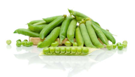 ripe pods of green peas on a white background with reflection. horizontal photo. Stock Photo - 18513171