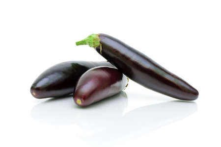 three ripe eggplant on a white background close-up Stock Photo - 18513158