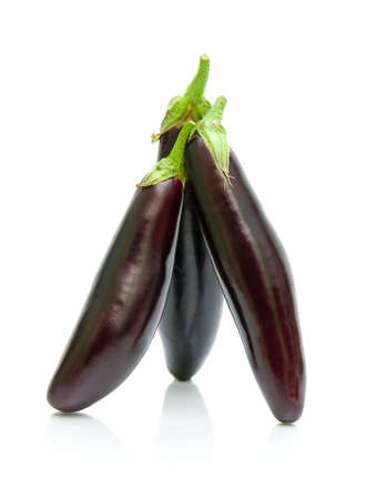 three ripe eggplant close-up on a white background. vertical photo. Stock Photo - 18513182