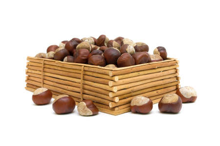 chestnuts in a wooden box isolated on white background. horizontal photo. Stock Photo - 18513184