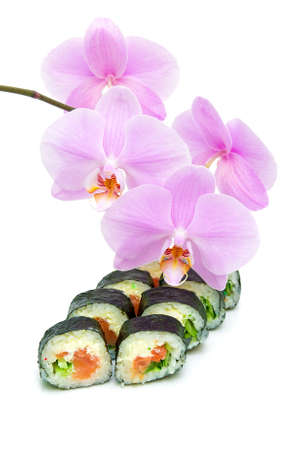 blossoming branch orchid and Japanese sushi on a white background close-up. vertical photo. Stock Photo - 18656625