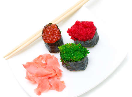 sushi and pickled ginger on a plate on a white background. horizontal photo. Stock Photo - 18656627