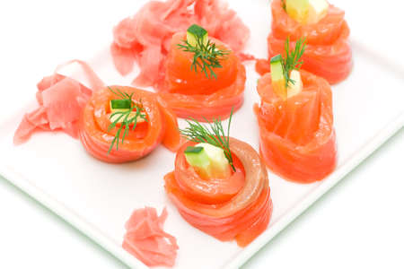 delicious salmon rolls with cheese and cucumber on white background close-up Stock Photo - 18656628