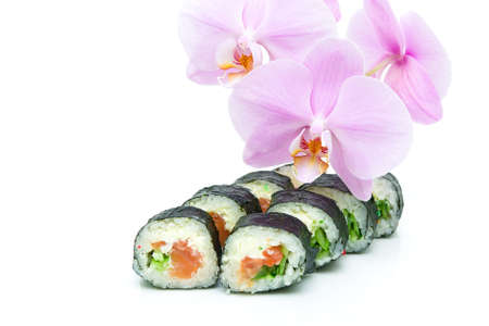 Japanese sushi and beautiful blooming orchid on a white background close-up. horizontal photo. Stock Photo - 18656622