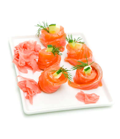 tasty rolls of trout with cucumber and dill on a white background close-up Stock Photo - 18656626
