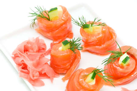 salmon roll with cucumber, cheese and dill and pickled ginger on a white background Stock Photo - 18656629