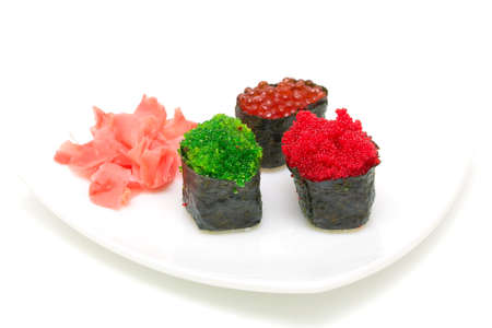 sushi with caviar of different types and pickled ginger on a white plate on a white background close-up Stock Photo - 18732411