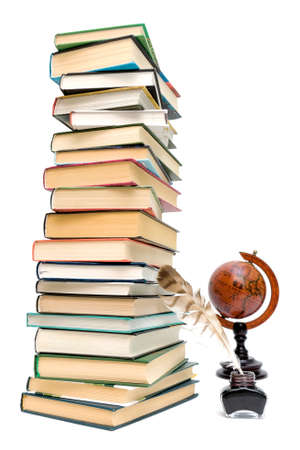 school supplies. pen in the ink, a large stack of books and a globe on a white background. Stock Photo - 18732415
