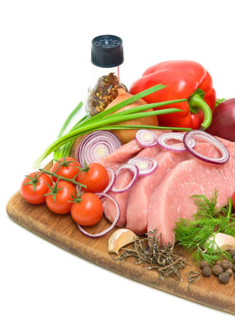 fresh vegetables and raw meat on a cutting board on a white background close-up Stock Photo - 18786420