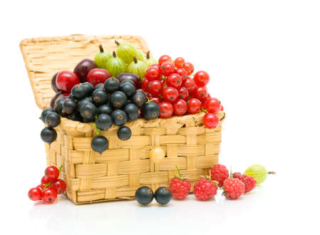 ripe juicy berries in a wicker basket on a white background Stock Photo - 18786431