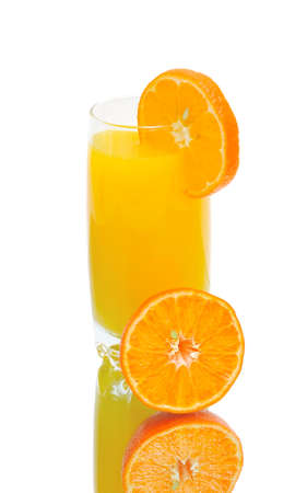 Half of juicy orange and a glass of orange juice on a white background with reflection. vertical photo. Stock Photo - 18786435