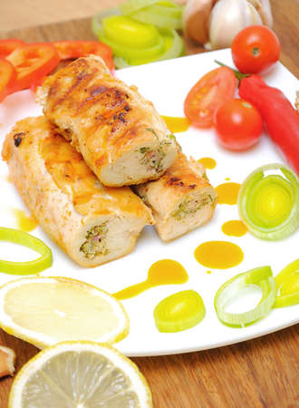 tasty rolls of chicken with vegetables and lemon Stock Photo - 18786437