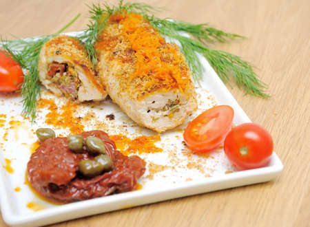 Chicken rolls, tomatoes and capers on a plate close-up Stock Photo - 18786425