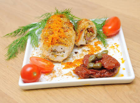 rolls of chicken with tomatoes and capers on a white plate. horizontal photo. Stock Photo - 18786424