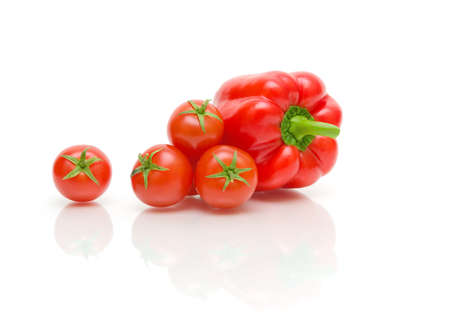 ripe cherry tomatoes and red peppers on a white background with reflection Stock Photo - 18786434