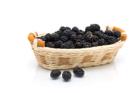 juicy ripe blackberries in a basket on a white background. horizontal photo. Stock Photo - 18786438