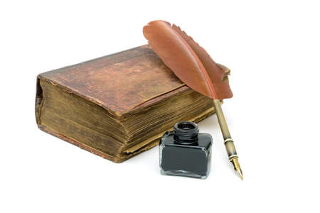an old edition of the New Testament, an inkwell and pen isolated on a white background. horizontal photo. Stock Photo - 19733869