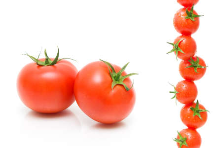ripe tomatoes on a white background close-up. horizontal photo. photo