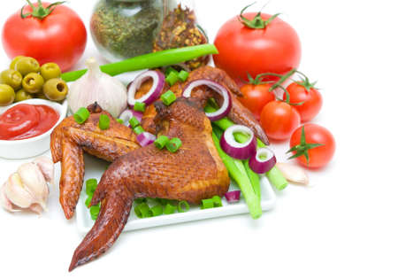 smoked chicken wings with vegetables, olives and ketchup on a white background. horizontal photo. Stock Photo - 19902699