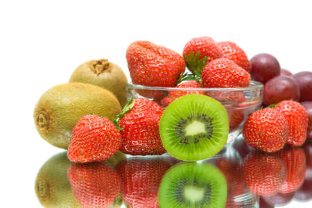 fruits and berries  kiwi, strawberry and grape close-up on a white background. photo
