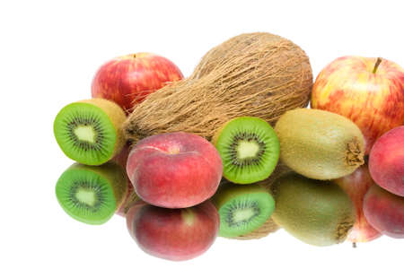 fresh fruit. kiwi, apples, peaches and coconut closeup on white background with reflection photo
