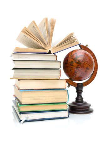 books and vintage globe isolated on a white background. vertical photo.