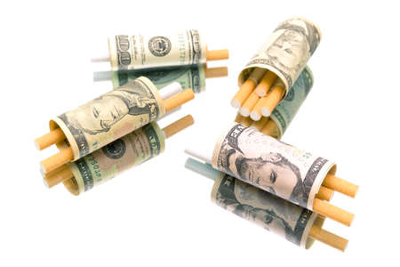cigarette smoke: money and cigarettes on a white background. expensive habit