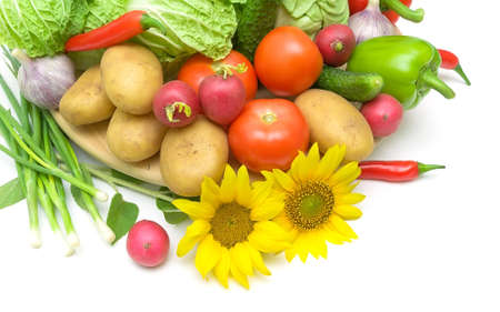 fresh vegetables and sunflowers on a white background close-up. horizontal photo. photo