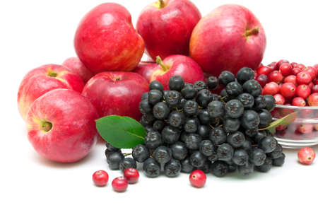 mountain cranberry: chokeberry, red apples and cranberries close-up on a white background. horizontal photo. Stock Photo