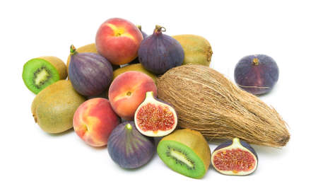 ripe fruit. figs, peaches, kiwi and coconut close up isolated on a white background.