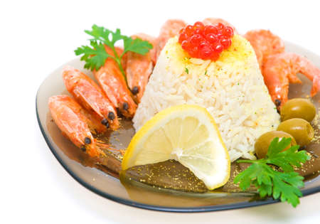 cooked rice with shrimp, caviar, lemon and olives close up on a white background. horizontal photo. photo