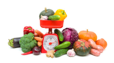 Kitchen scales and fresh ripe vegetables isolated on a white background. horizontal photo. photo