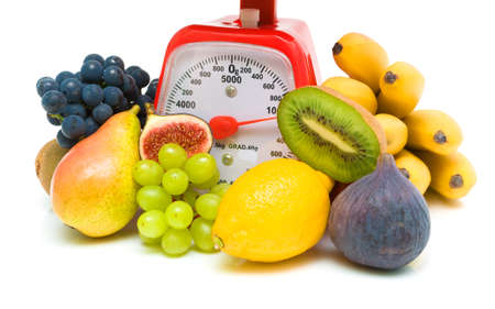 fresh juicy fruits and kitchen scales close up on a white background. horizontal photo. photo
