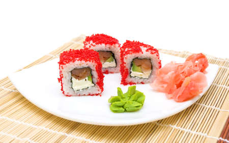 Japanese cuisine. Rolls, pickled ginger and wasabi on a white plate. Horizontal photo. photo