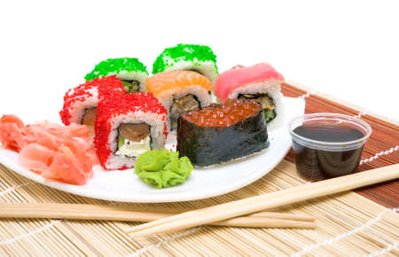 sushi with red caviar, rolls, pickled ginger, wasabi and soy sauce close-up. horizontal photo. photo