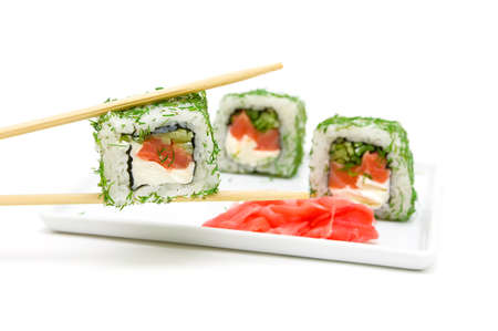 Japanese cuisine. rolls and pickled ginger on a plate on a white close-up. horizontal photo. photo